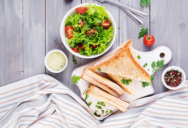Club sandwich panini with ham, cheese and salad. Top view. Tasty breakfast royalty free stock photos