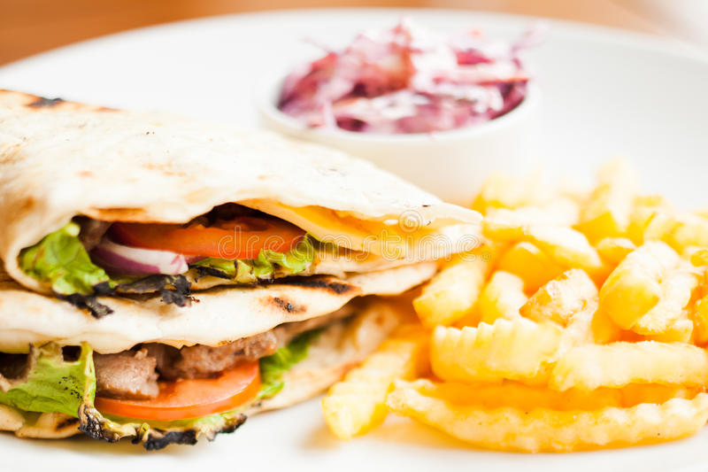 Club sandwich. In pita with fried potato and salad royalty free stock photo