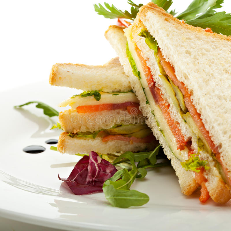 Club Sandwich. With Salmon and Vegetables stock photos