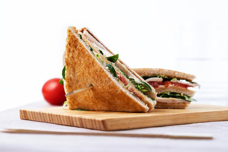 Club sandwich, with tomato, lettuce and cheese on white background. Club sandwich: tomato, lettuce cheese stock image