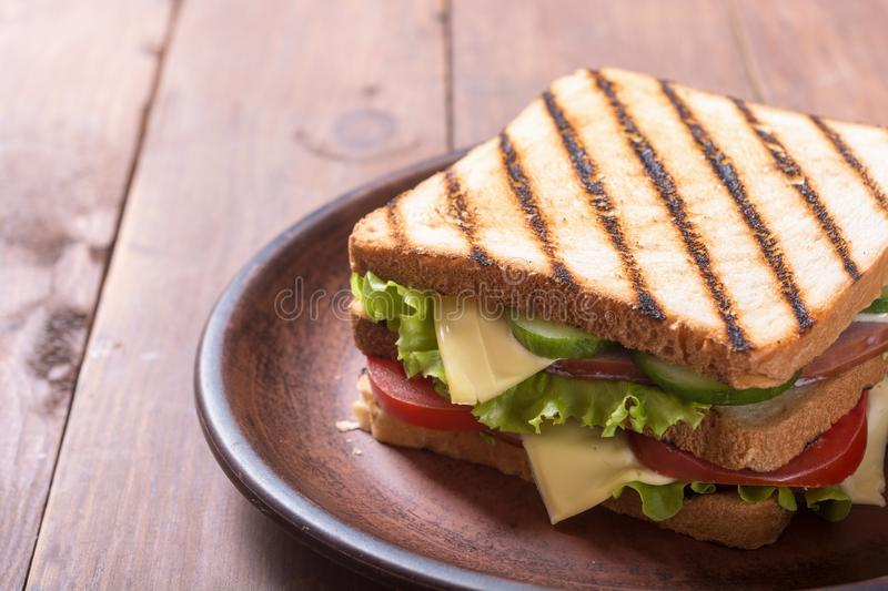 Club sandwich with tomatoes , cucumber , ham and cheese. Club sandwich with tomatoes , cucumber , ham , cheese and salad . Clubsandwich stock images