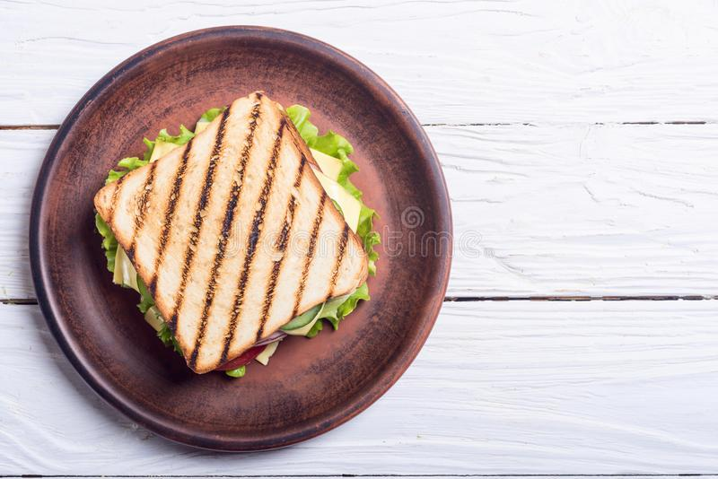 Club sandwich with tomatoes , cucumber , ham and cheese. Club sandwich with tomatoes , cucumber , ham , cheese and salad . Clubsandwich stock photo