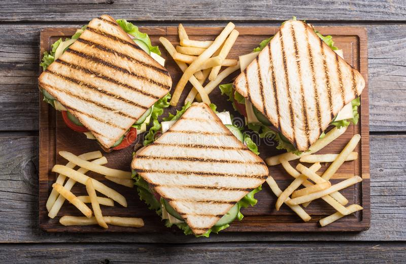 Club sandwich with tomatoes , cucumber , ham and cheese. Club sandwich with tomatoes , cucumber , ham , cheese and salad . Clubsandwich royalty free stock photo