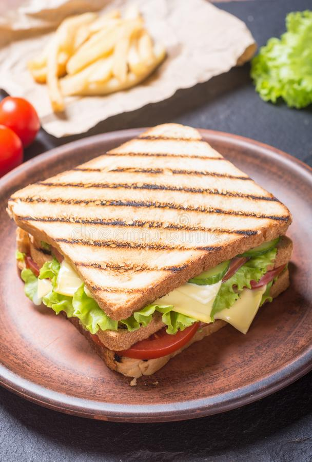 Club sandwich with tomatoes , cucumber , ham and cheese. Club sandwich with tomatoes , cucumber , ham , cheese and salad . Clubsandwich stock image