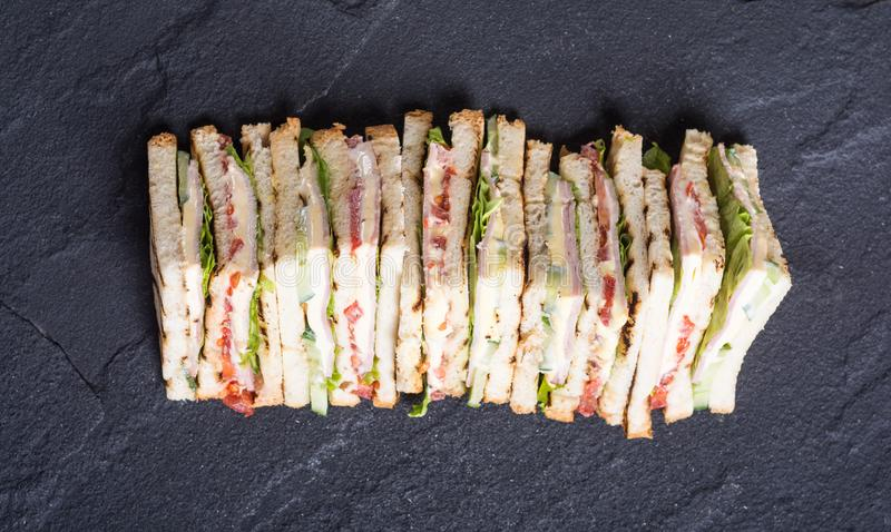 Club sandwich with tomatoes , cucumber , ham and cheese. Club sandwich with tomatoes , cucumber , ham , cheese and salad . Clubsandwich stock photography