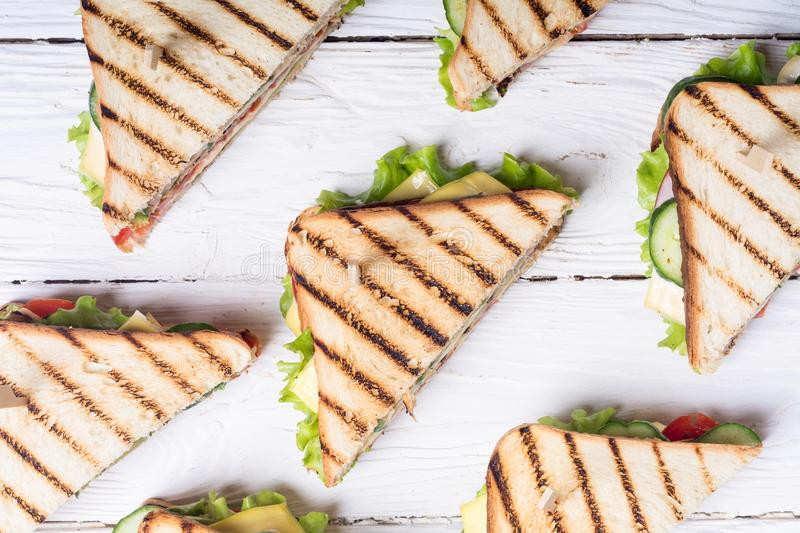 Club sandwich with tomatoes , cucumber , ham and cheese. Club sandwich with tomatoes , cucumber , ham , cheese and salad . Clubsandwich royalty free stock images