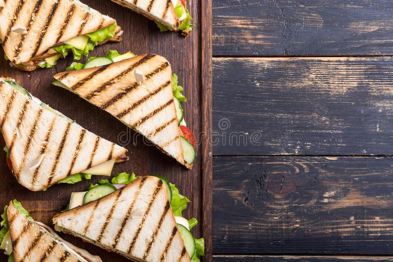 Club sandwich with tomatoes , cucumber , ham and cheese. Club sandwich with tomatoes , cucumber , ham , cheese and salad . Clubsandwich royalty free stock photos