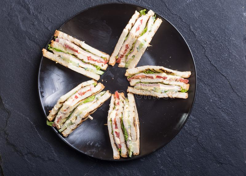 Club sandwich with tomatoes , cucumber , ham and cheese. Club sandwich with tomatoes , cucumber , ham , cheese and salad . Clubsandwich stock photos