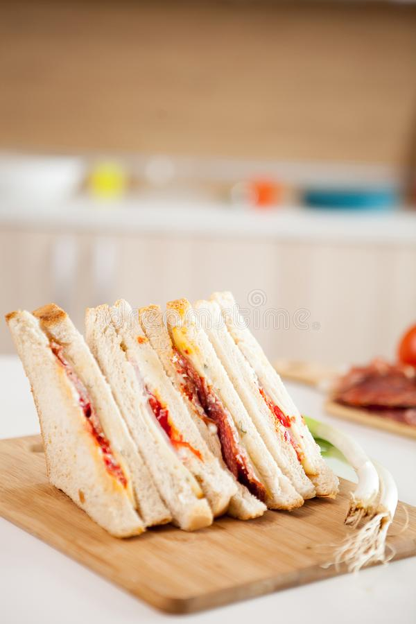 Club sandwich with white bread. On the kitchen stock photography
