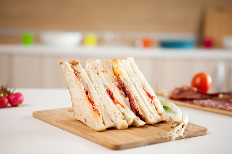 Club sandwich with white bread royalty free stock photo