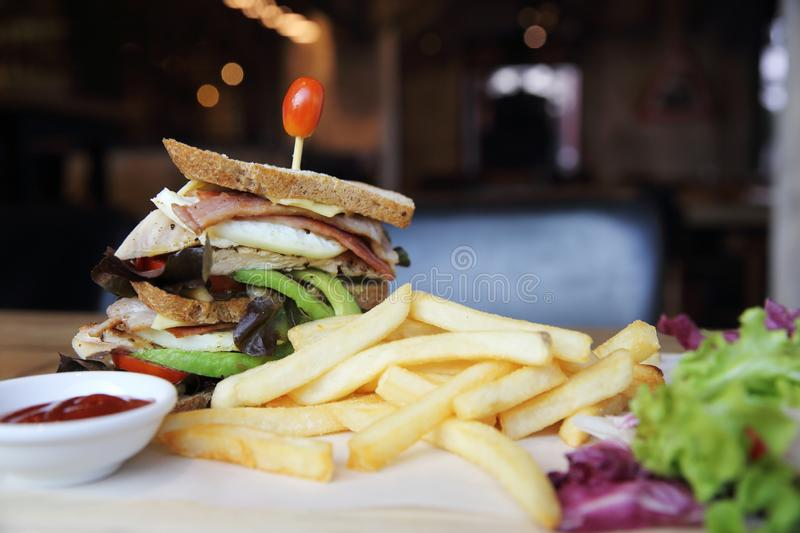 Club sandwich with on wood background. In close up stock photos