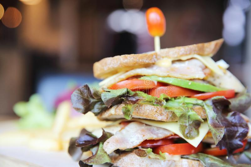 Club sandwich with on wood background. In close up stock images