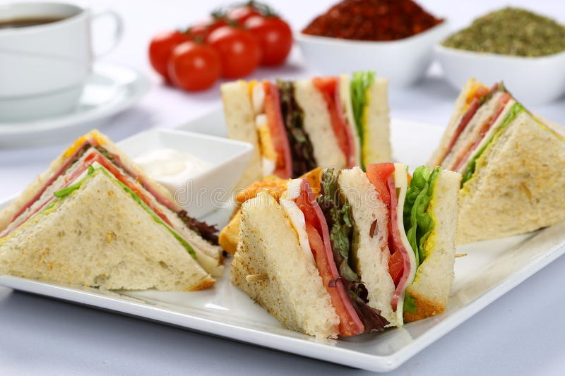 Club Sandwiches. Chicken club sandwiches with potato crisps and coffee stock photos