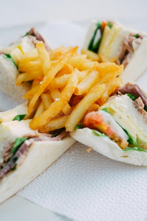 Club sandwiches and french fries. breakfast on the table.  stock photography