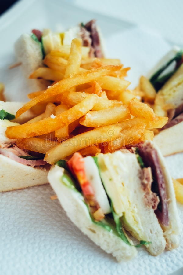 Club sandwiches and french fries. breakfast on the table.  royalty free stock photos
