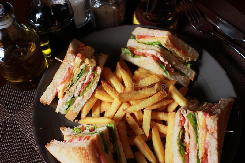 Club sandwiches with french fries. Tasty food royalty free stock photography