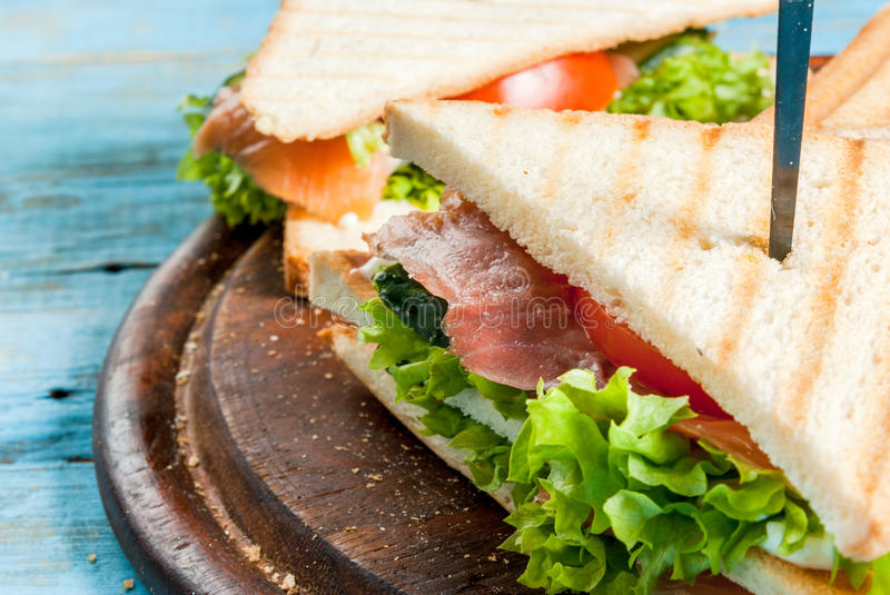 Club sandwiches with salmon royalty free stock images