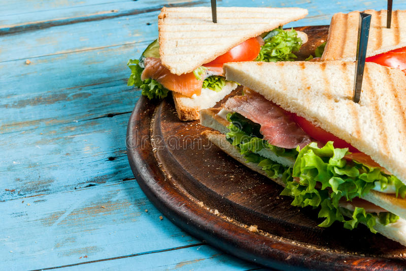 Club sandwiches with salmon stock image