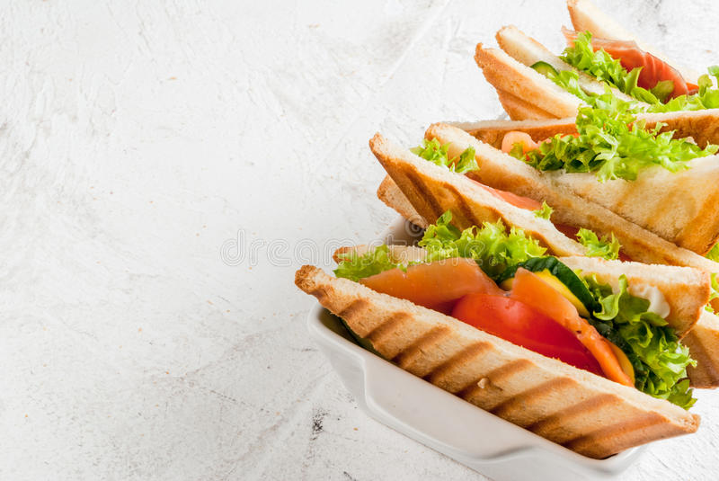 Club sandwiches with salmon royalty free stock image