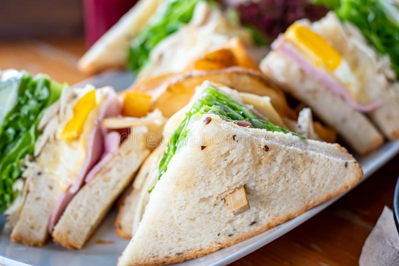 Club whole wheat sandwich with ham and organic vegetable and eggs.Healthy Breakfast.  royalty free stock photography