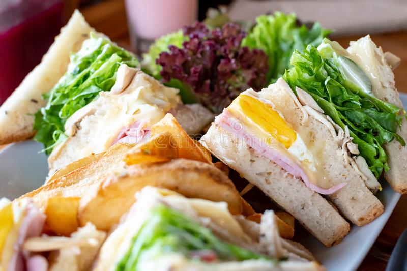Club whole wheat sandwich with ham and organic vegetable and eggs.Healthy Breakfast.  stock photo