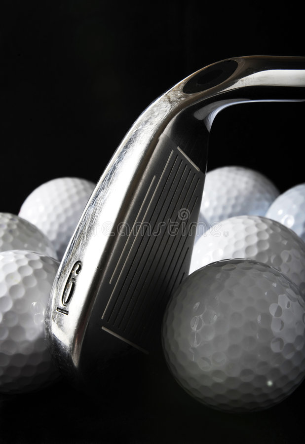 Clube e esferas de golfe fotos de stock