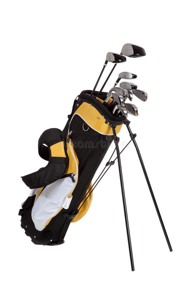 Clubes e saco de golfe no branco imagem de stock