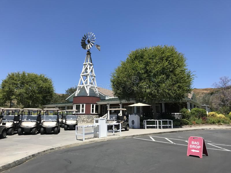 Clubhouse and bag drop off area at the Strawberry Farms Golf Club. IRVINE, CALIFORNIA - JULY 1, 2019: Clubhouse and bag drop off area at the Strawberry Farms royalty free stock photo