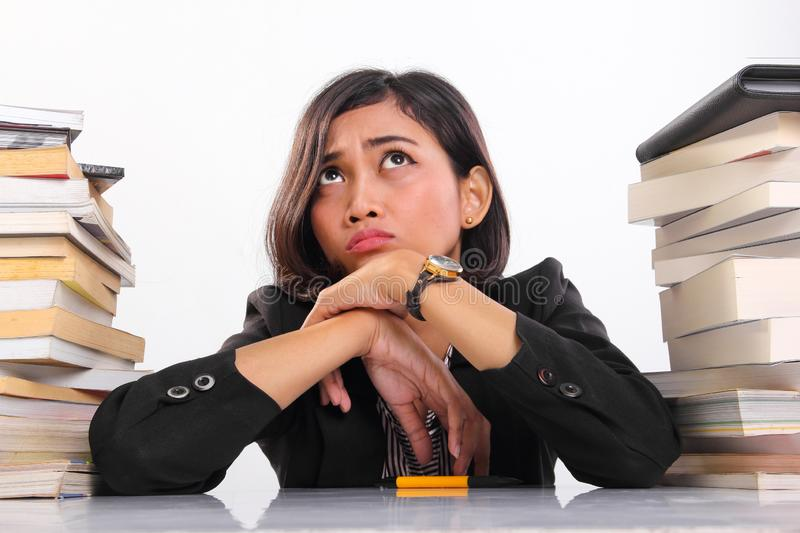 Clueless faced female student thinking hard in desperation royalty free stock images