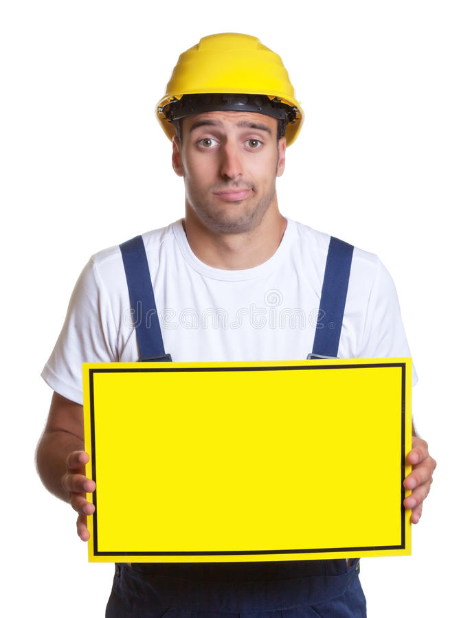Clueless latin construction worker with sign royalty free stock images