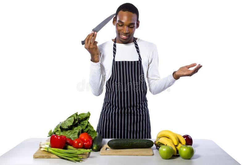 Clueless Mannelijke Chef-kok op een Witte Achtergrond stock afbeelding
