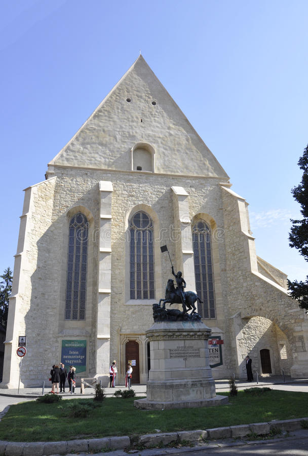 Cluj-Napoca RO, September 23th: St George Statue front of Reformed Church in Cluj-Napoca from Transylvania region in Romania royalty free stock photo