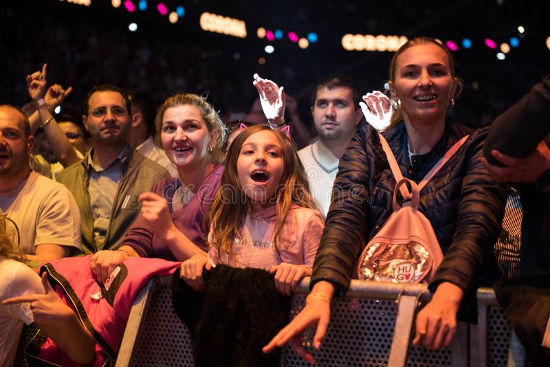 Crowd of cheerful people partying at a live concert. CLUJ NAPOCA, ROMANIA - NOVEMBER 19, 2017: Crowd of cheerful people dancing and partying during the We Love stock image
