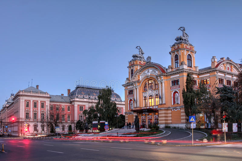 Cluj Napoca, Romania. Twilight in Cluj Napoca, Romania with the Lucian Blaga National Theatre and the Palace of Justice stock photos