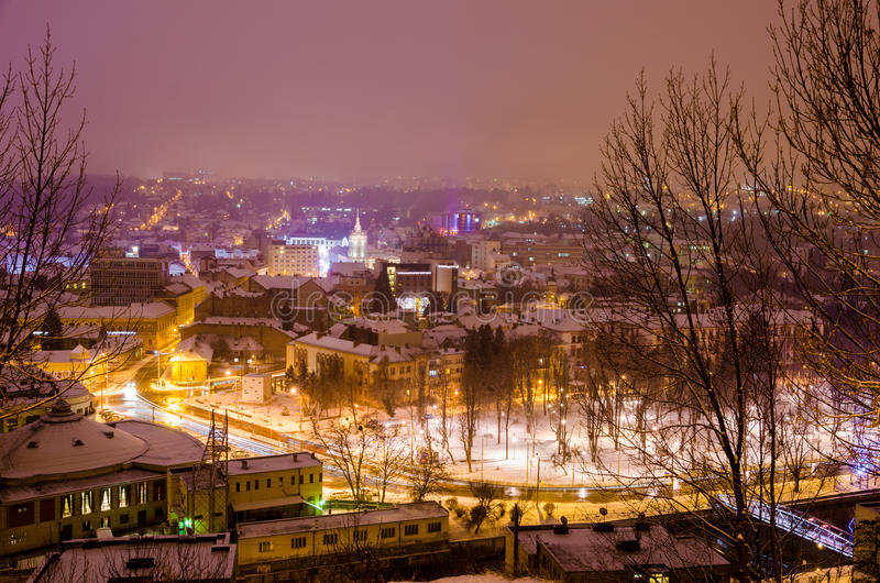 Cluj Napoca winter night view with lights. Cluj Napoca view on a cold winter night with the Hungarian Opera House, The Faculty of Chemistry and Central Park with royalty free stock photos