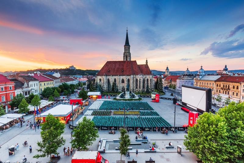 Cluj, Romania. 2 June, 2018 - Medieval St. Michael`s Church and Union Square at sunset during Transilvania International Film Festival TIFF royalty free stock photography