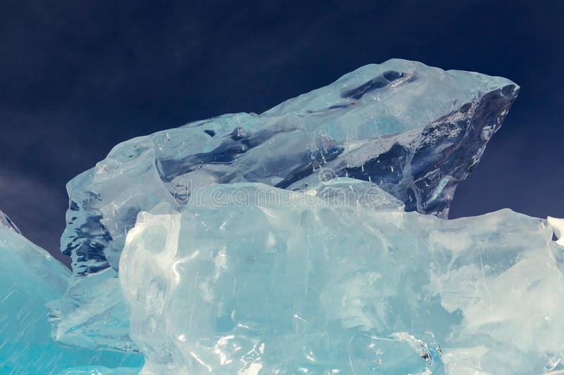Clumps of clear ice on sky background. royalty free stock photography