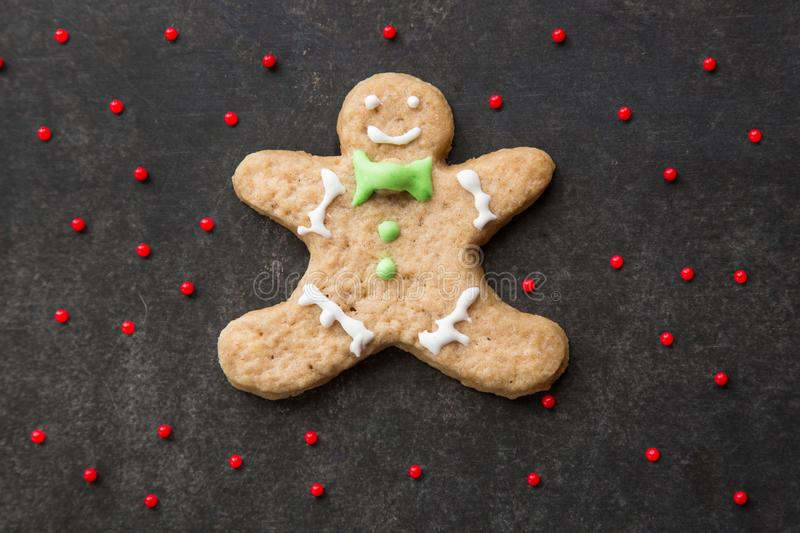 Clumsy christmas homemade ginger cookie man. stock photo