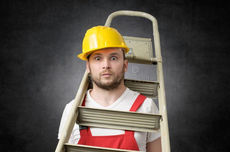 Clumsy worker with ladder royalty free stock image