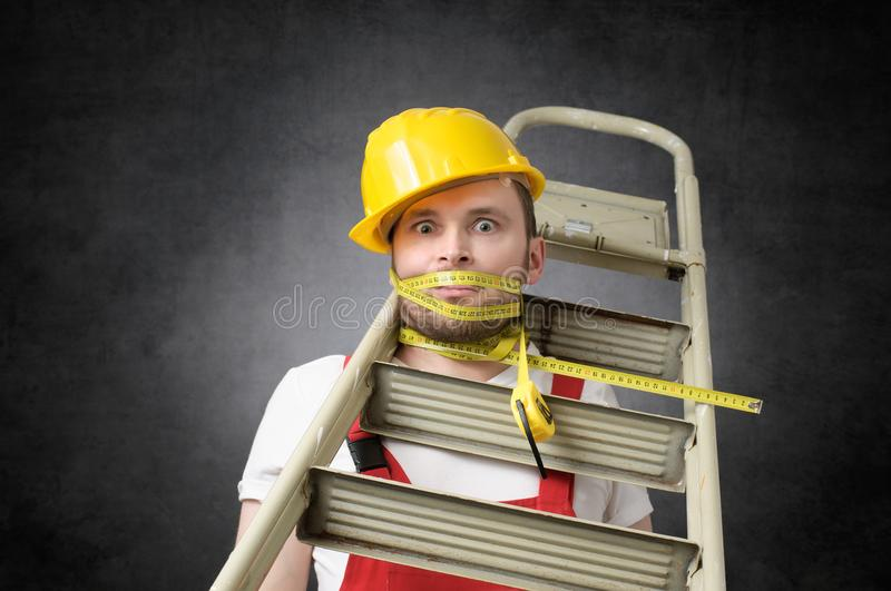 Clumsy worker with measure tape stock photo