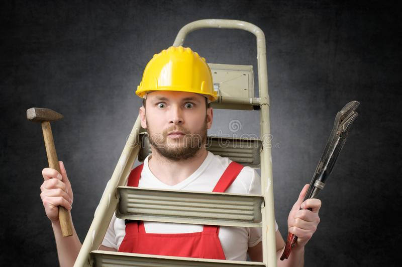 Clumsy worker with tools stock images