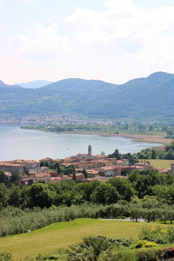 Clusane, Lake Iseo, Italy. View on Clusane, a small historic village on the southern end of lake Iseo, the fourth largest lake in Lombardy, Italy. There are royalty free stock photography