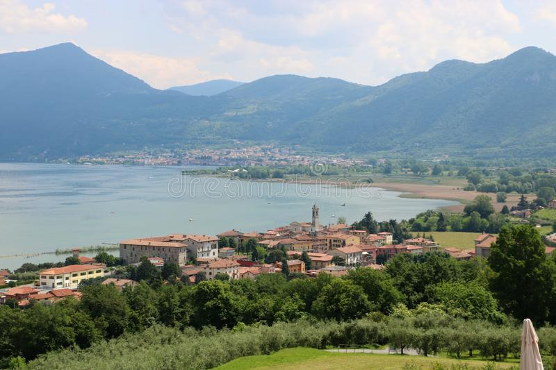 Clusane, Lake Iseo, Italy. View on Clusane, a small historic village on the southern end of lake Iseo, the fourth largest lake in Lombardy, Italy. There are royalty free stock photo