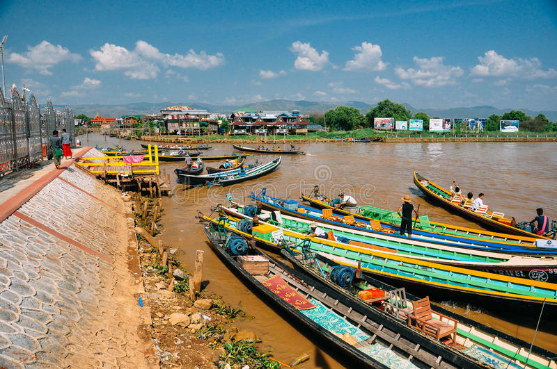 A cluster of colorful boats at Inle Lake. stock photos
