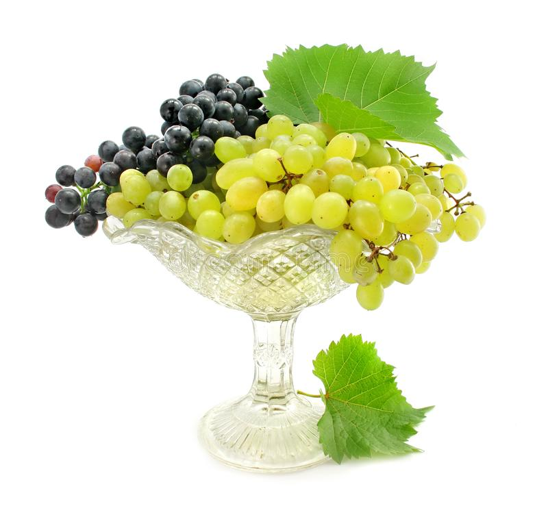 Cluster green and blue grape isolated on white stock photography