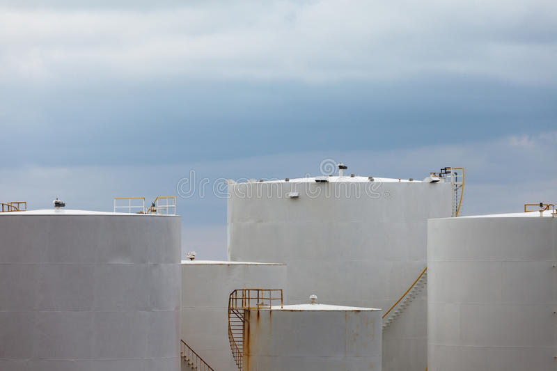 Cluster of petroleum products storage tanks royalty free stock images
