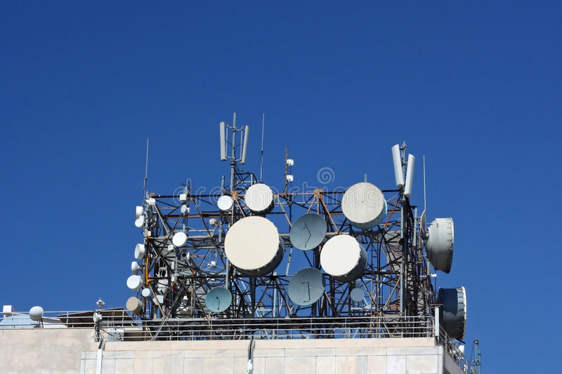 Cluster of Telecommunication Antennas. A cluster of antennas on top of a telecommunication-agency building royalty free stock image