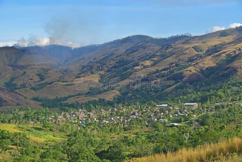 Cluster van Fijian bure in vallei van Navala, een dorp in de Bedelaarshooglanden van noordelijke centrale Viti Levu, Fiji royalty-vrije stock fotografie