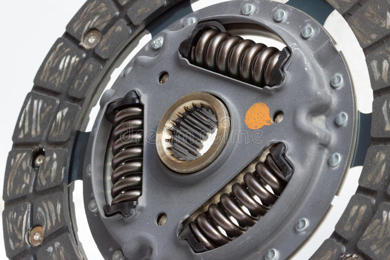 Clutch disc. New clutch disc on a white background stock photos