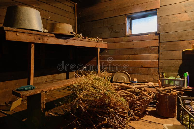 Clutter and many different things in a old barn. Clutter and many different things in a wooden old barn royalty free stock photos